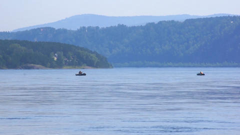 River Yenisei 09 with two fishing boats Stock Video Footage