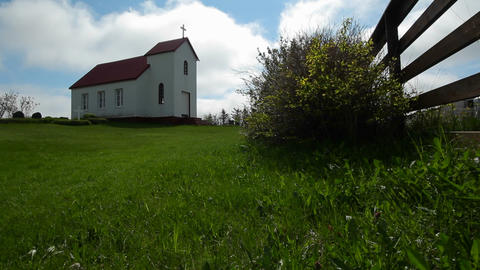A small church near a fence in Iceland or a Scandi Footage