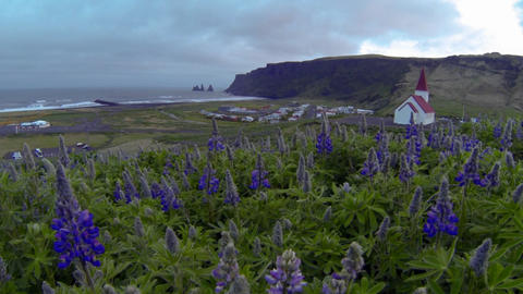 A church overlooks a small Iceland village Stock Video Footage