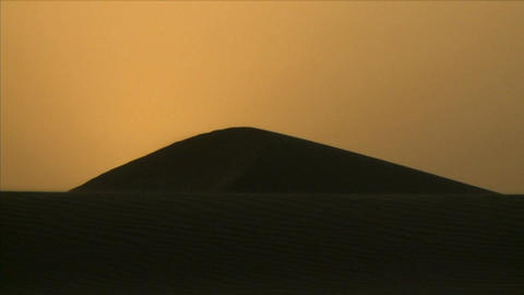 Time lapse shot of sunrise over desert sand dunes Stock Video Footage