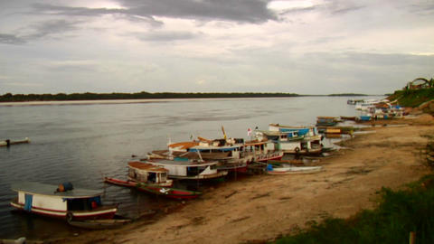 Boats line the Amazon River in Brazil Stock Video Footage
