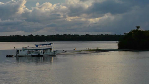 River boats come into a small harbor on the Amazon Footage