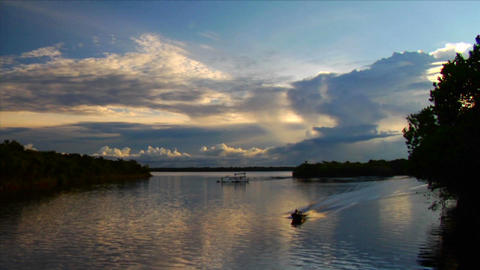 A motorboat passes quickly along the Amazon River  Footage