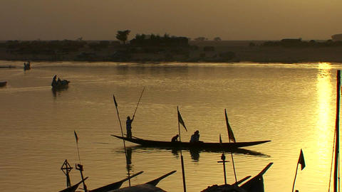 Boats are rowed on the Niger River in beautiful go Stock Video Footage