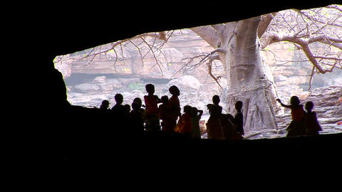 Children stand silhouetted in a cave in Mali, Afri Footage