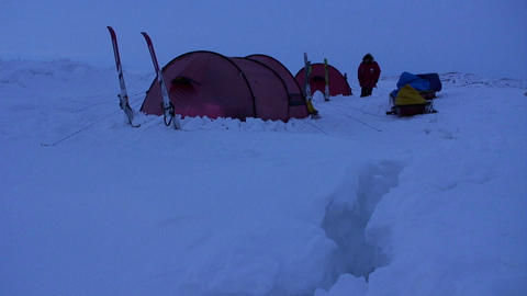 Campers in deep snow on an Arctic expedition at ni Footage
