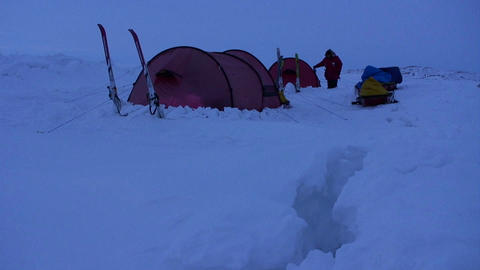 Campers in deep snow on an Arctic expedition at ni Stock Video Footage