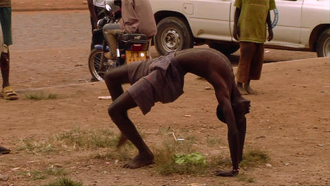 An African man does a bizarre rap dance with his l Stock Video Footage