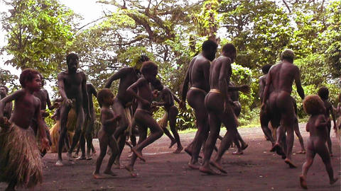New Guinea natives do a traditional dance in the j Footage