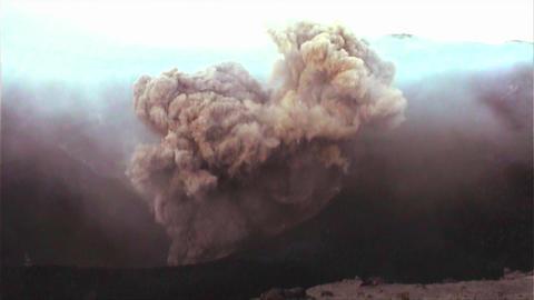 Handheld shot of a volcano erupting Stock Video Footage