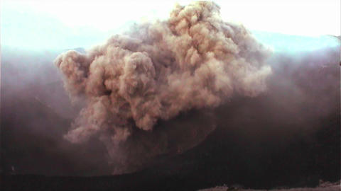 Handheld shot of a volcano erupting Stock Video Footage