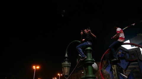 An Egyptian youth flashes the peace sign at a prot Stock Video Footage
