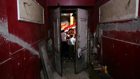 A doorway frames protestors in Cairo, Egypt Footage