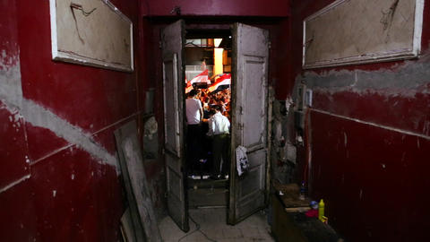 A doorway frames protestors in Cairo, Egypt Stock Video Footage