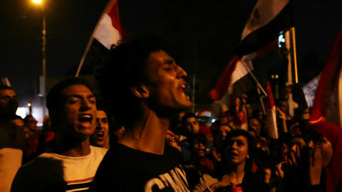 Demonstrators chant at a nighttime rally in Tahrir Footage