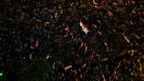 Crowds protest at a nighttime rally in Tahrir Squa Footage