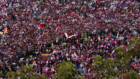 Overhead view of a large rally in Tahrir Square in Stock Video Footage