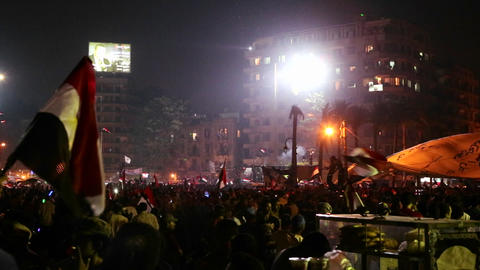 A large nighttime rally with fireworks in Tahrir S Stock Video Footage