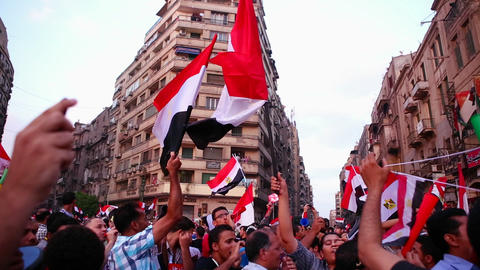 Protestors chant and wave flags in Cairo, Egypt Footage