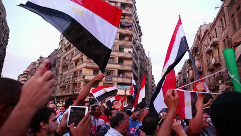 Protestors chant and wave flags in Cairo, Egypt Stock Video Footage