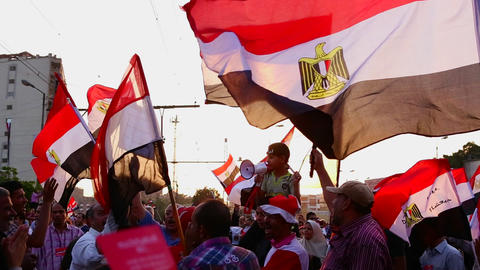 The sun shines through protestor's flags in Cairo, Stock Video Footage