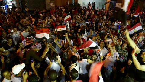 Protestors jam the streets and wave flags in Cairo Stock Video Footage