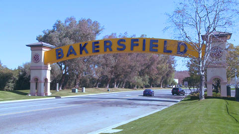 Cars drive into Bakersfield, California under the Stock Video Footage