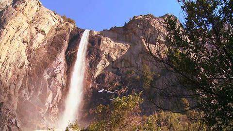Low angle pan across a beautiful waterfall in Yose Stock Video Footage