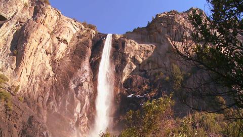 Low angle pan across a beautiful waterfall in Yose Footage