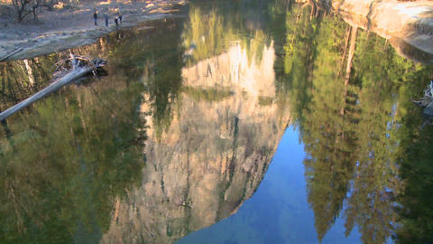 El Capitan is reflected in the Merced River in Yos Stock Video Footage
