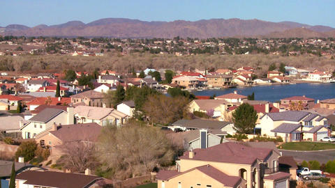 Birds eye view over suburban sprawl in a desert co Stock Video Footage