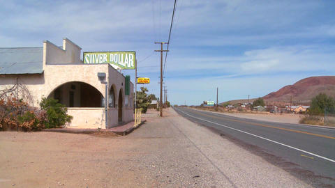 An old bar or diner sits in the Mojave desert Live Action