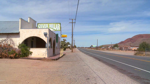 An old bar or diner sits in the Mojave desert Stock Video Footage