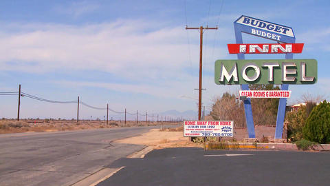 A budget motel along a desert highway by day Stock Video Footage