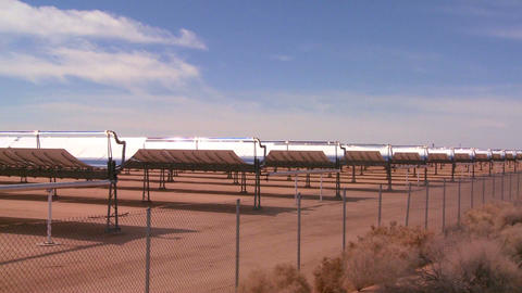Pan across a solar farm in the desert generates el Stock Video Footage