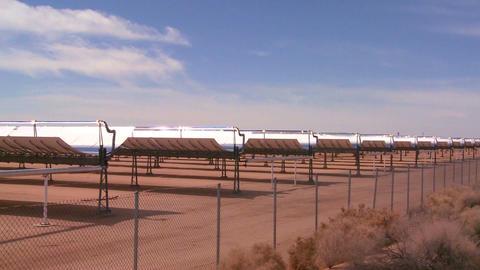 Pan across a solar farm in the desert generates el Stock Video Footage