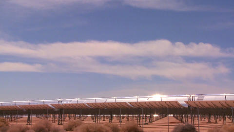 Time lapse of clouds over a solar generating farm Stock Video Footage
