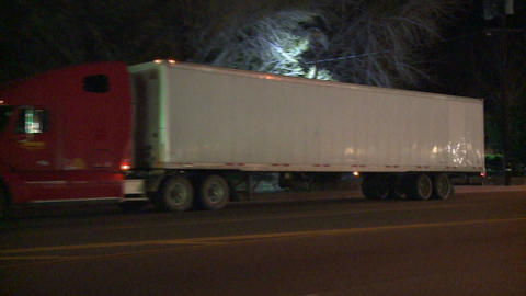 An unmarked double tractor trailer truck drives th Stock Video Footage