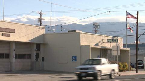 An establishing shot of a police station in an Ame Stock Video Footage