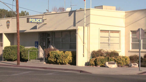 An establishing shot of a police station in an Ame Footage