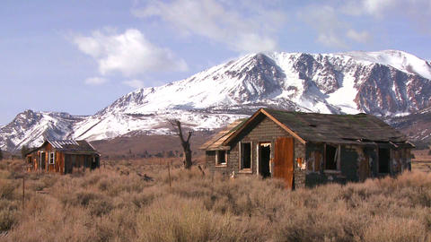 Abandoned settler cabins with the snowcapped Sierr Footage