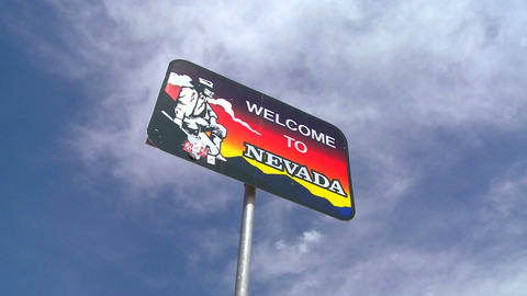 A sign welcomes visitors to Nevada Stock Video Footage