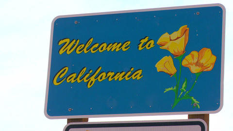 A sign welcomes visitors to California Stock Video Footage