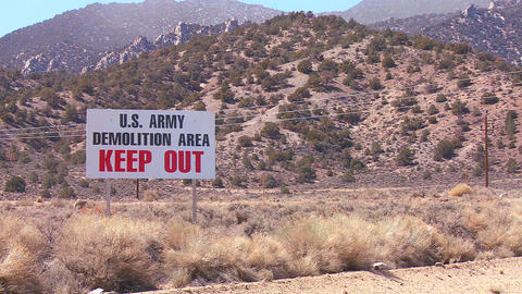 A sign warns trespassers not to enter an army prov Stock Video Footage