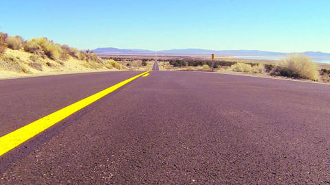 Dolly shot along an open road past the center line Stock Video Footage