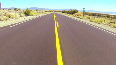 POV shot driving along a desert road at a fast spe Stock Video Footage