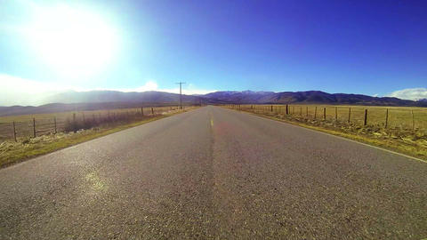 POV shot driving along a country road at a fast sp Footage