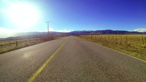 POV shot driving along a country road at a fast sp Stock Video Footage