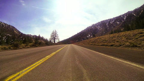 POV shot driving fast along a mountain road Stock Video Footage