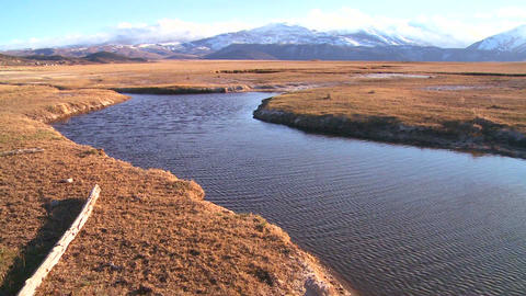 Pan across a beautiful mountain river and valley i Stock Video Footage